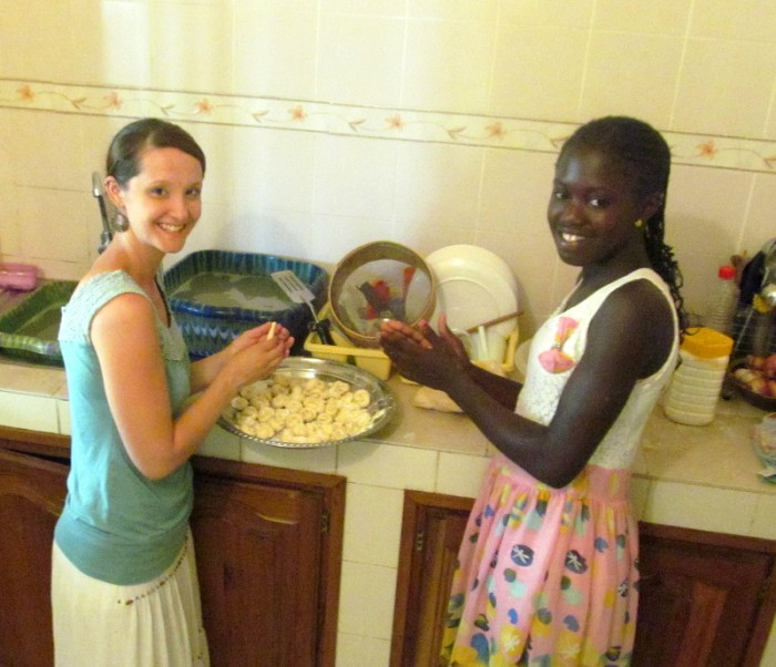 We had a teenage girl stay with us for 5 days, while her family was out of town. Here she is teaching me to make benets.