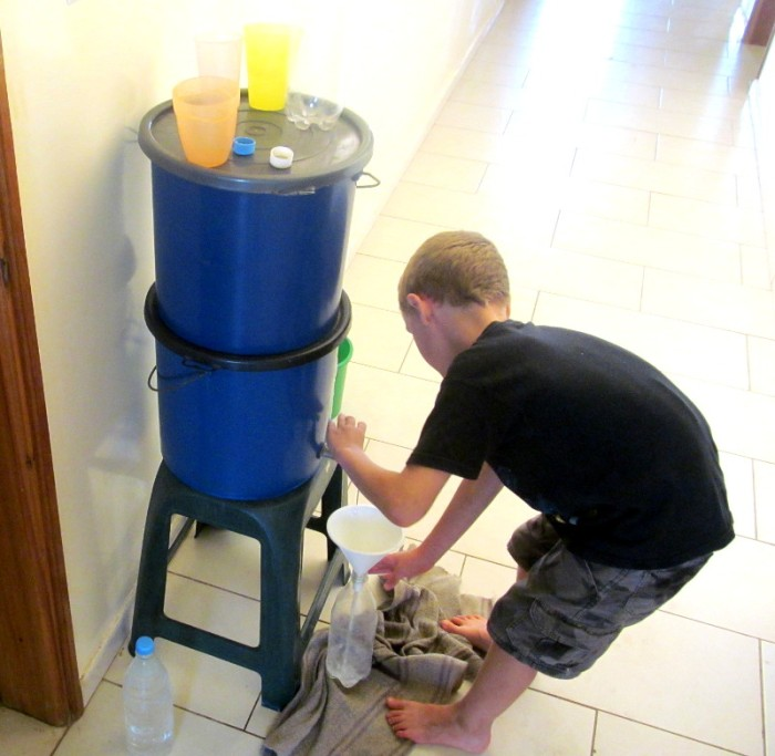 Calvin filling up water from the filter.